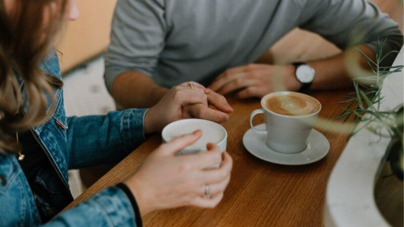 girl and guy deep conversation over coffee (1)